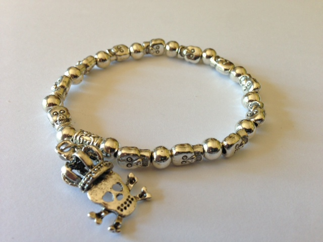 Skull and Crown charm on a Silver-Tone Skull and Beads Stretch Bracelet